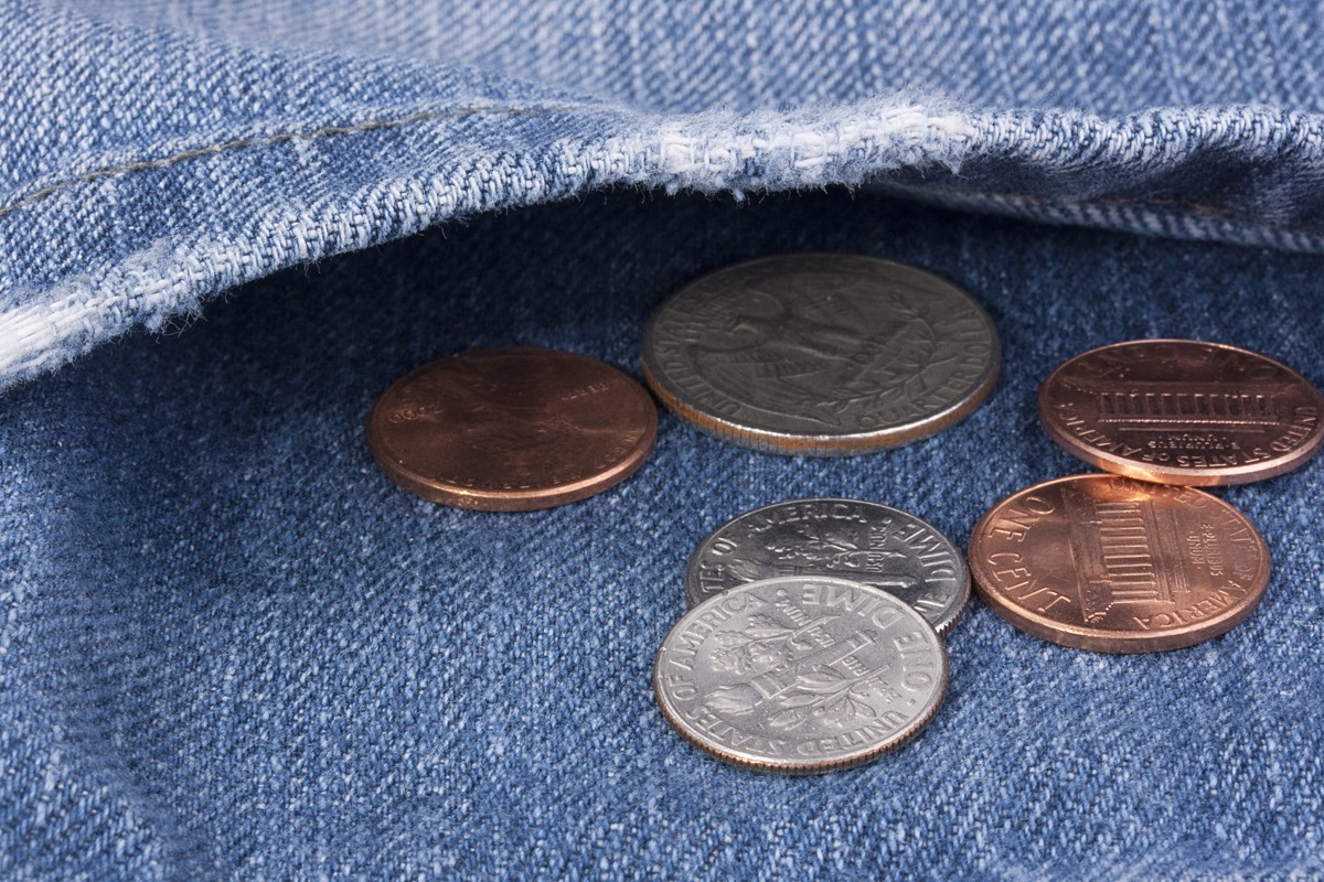 coins in the pocket of jeans