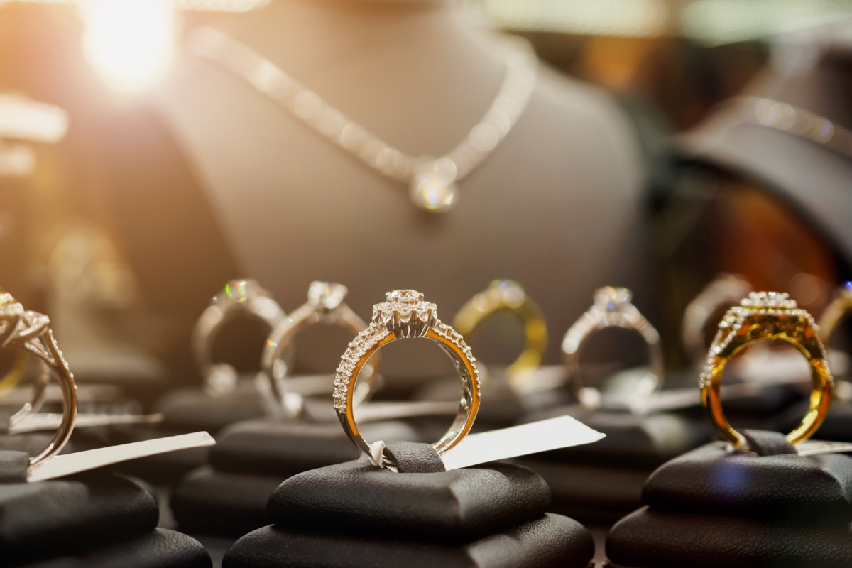 Jewelry diamond rings and necklaces show in luxury retail store window display showcase - Image