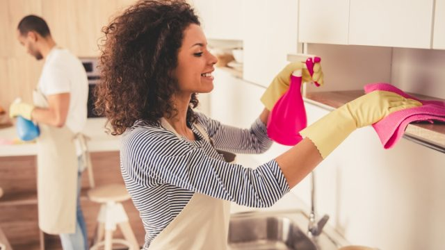 couple spring cleaning their kitchen, easy home tips