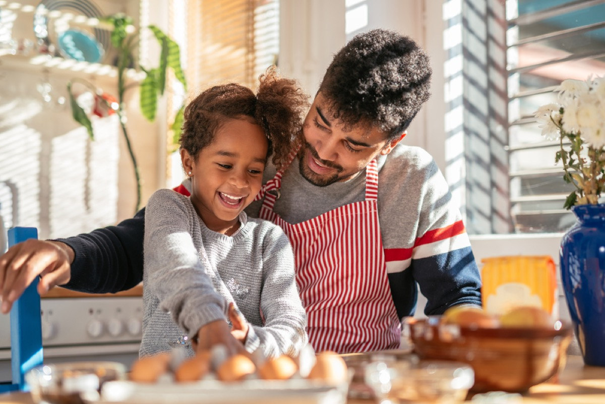 dad cooking with his daughter, skills parents should teach kids