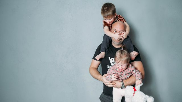father with kids climbing all over him, bad parenting advice