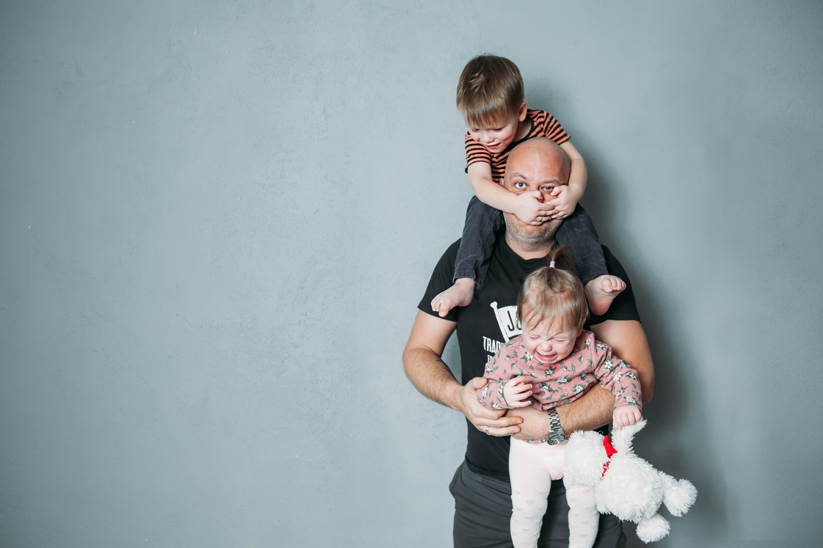 father with kids climbing all over him, ways parenting has changed