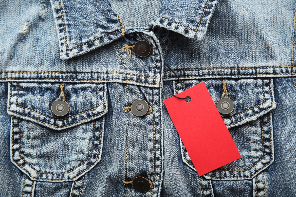 Red sale tag with jeans jacket - Image