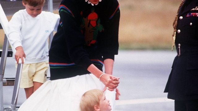Diana and William and Harry getting off an airplane