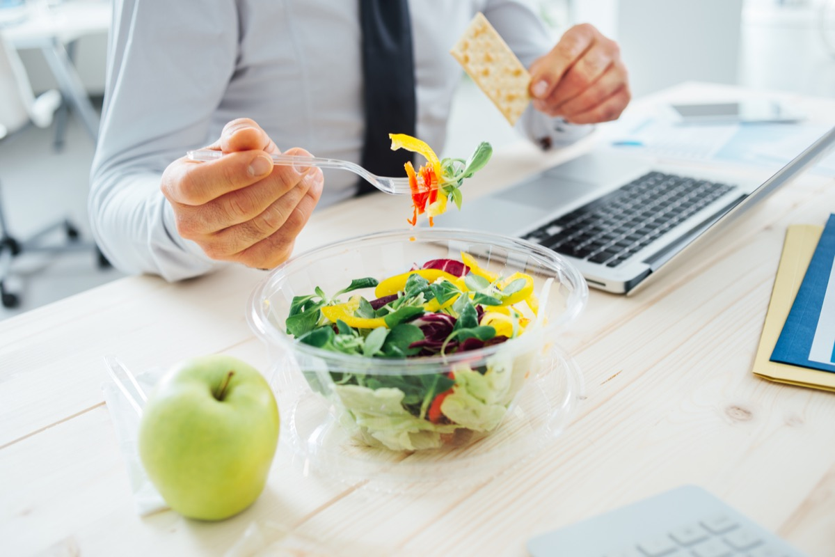 Businessman on a diet eating a salad