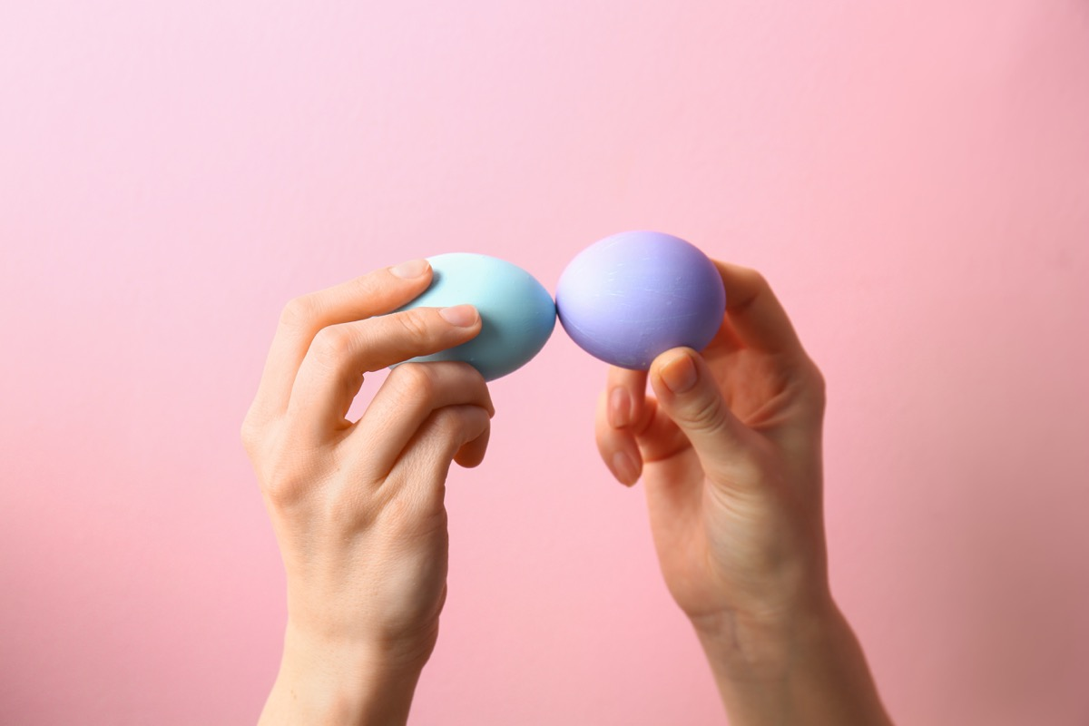people playing egg tapping game, easter games