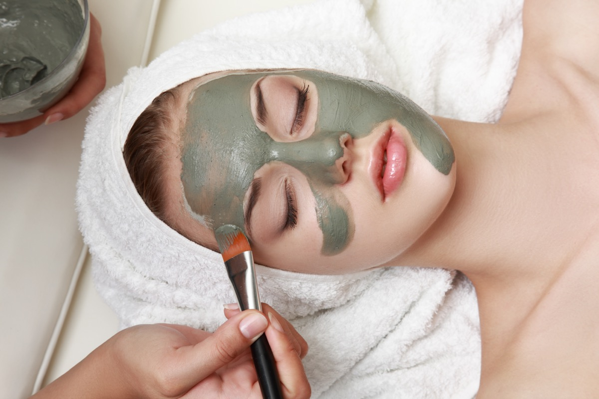 Woman getting a green facial