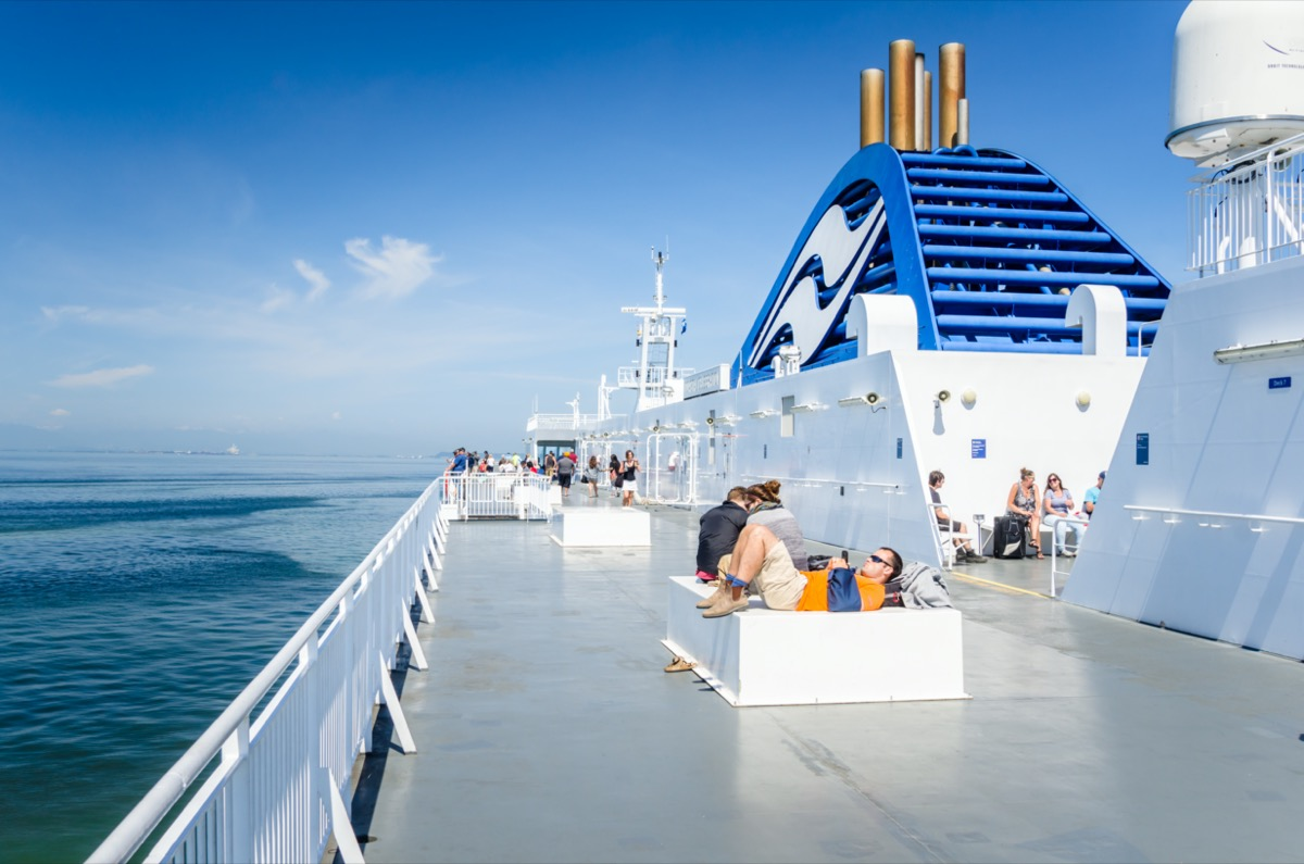 people relaxing outside on cruise with funnels on the side