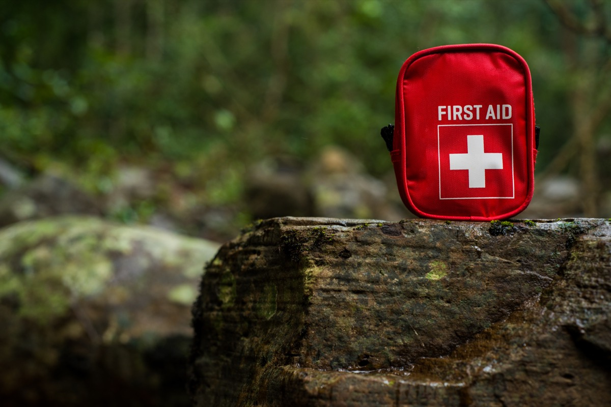 first aid kit bag on stone in nature - Image