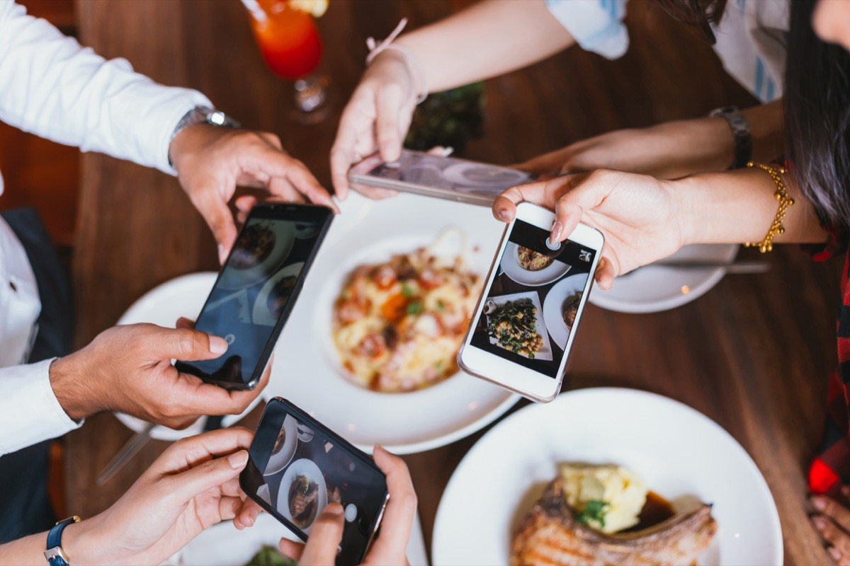 Foodies taking pictures of meal