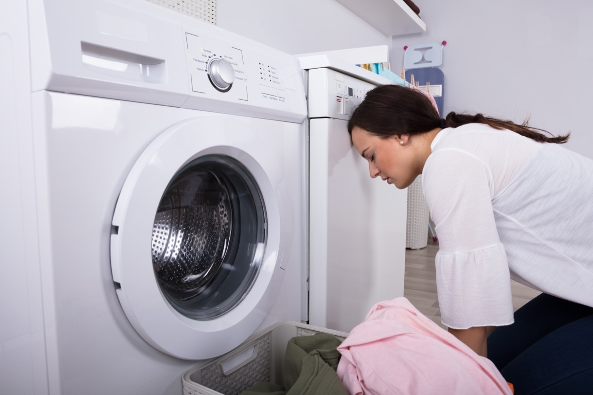 frustrated woman doing laundry