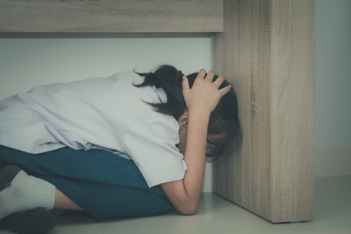 young girl hiding under desk, parenting is harder