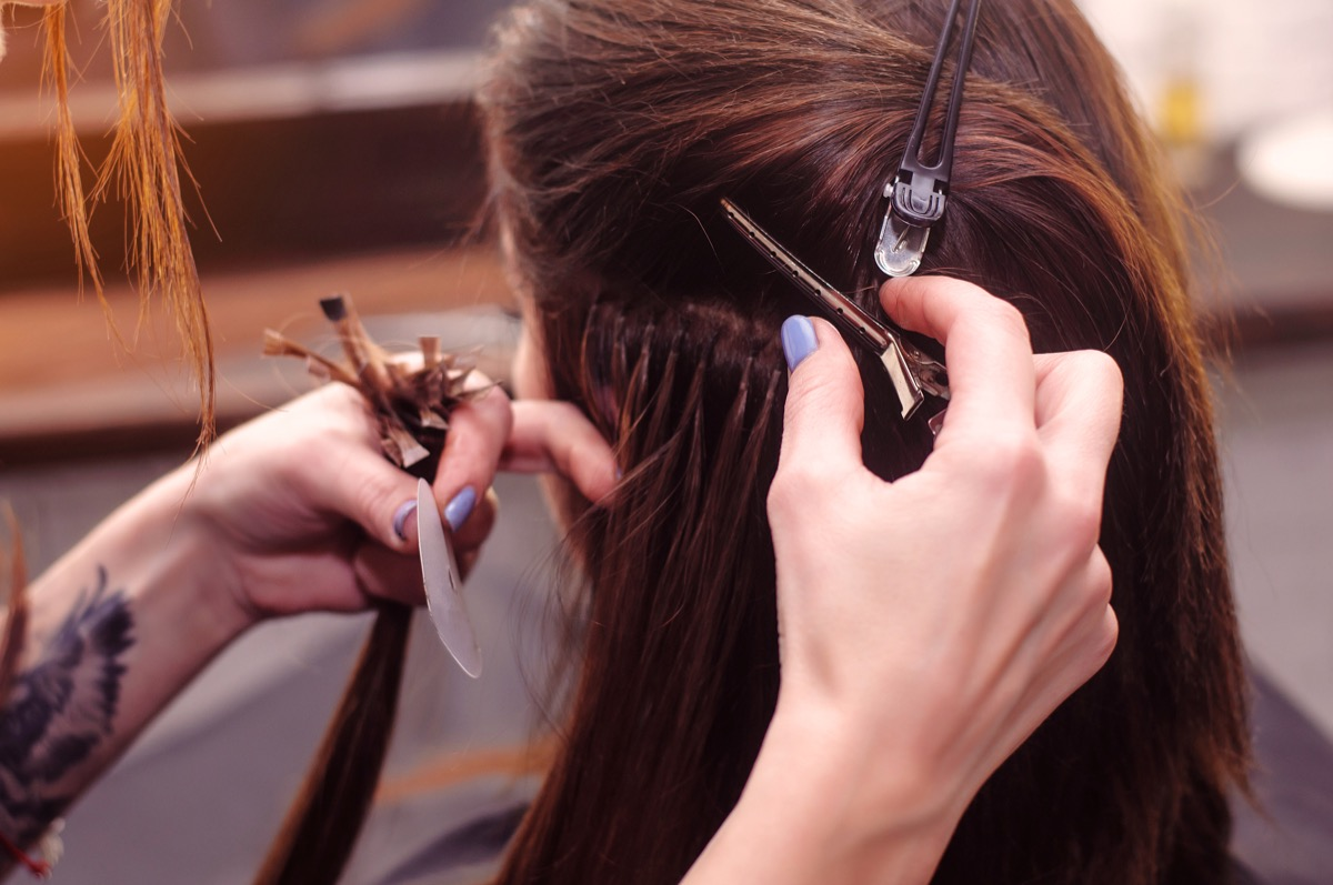 hair extension in a professional beauty salon.Barbershop - Image