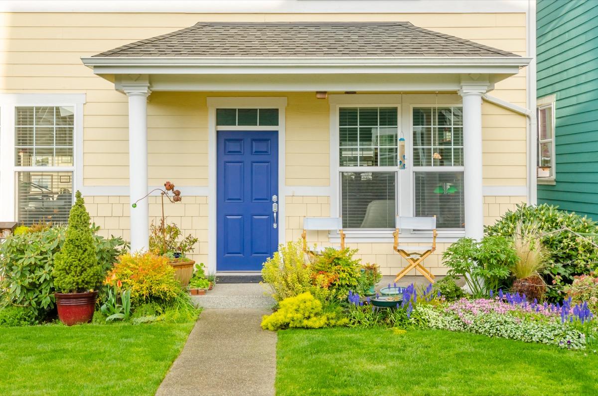 Yellow house with blue door