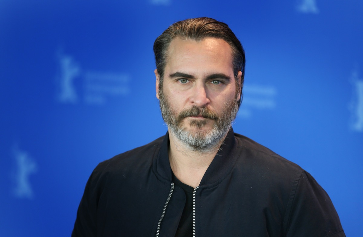 vegan celebrities - Joaquin Phoenix poses at the 'Don't Worry, He Won't Get Far on Foot' photo call during the 68th Berlinale Film Festival Berlin at Hyatt Hotel on February 20, 2018 in Berlin, Germany. - Image