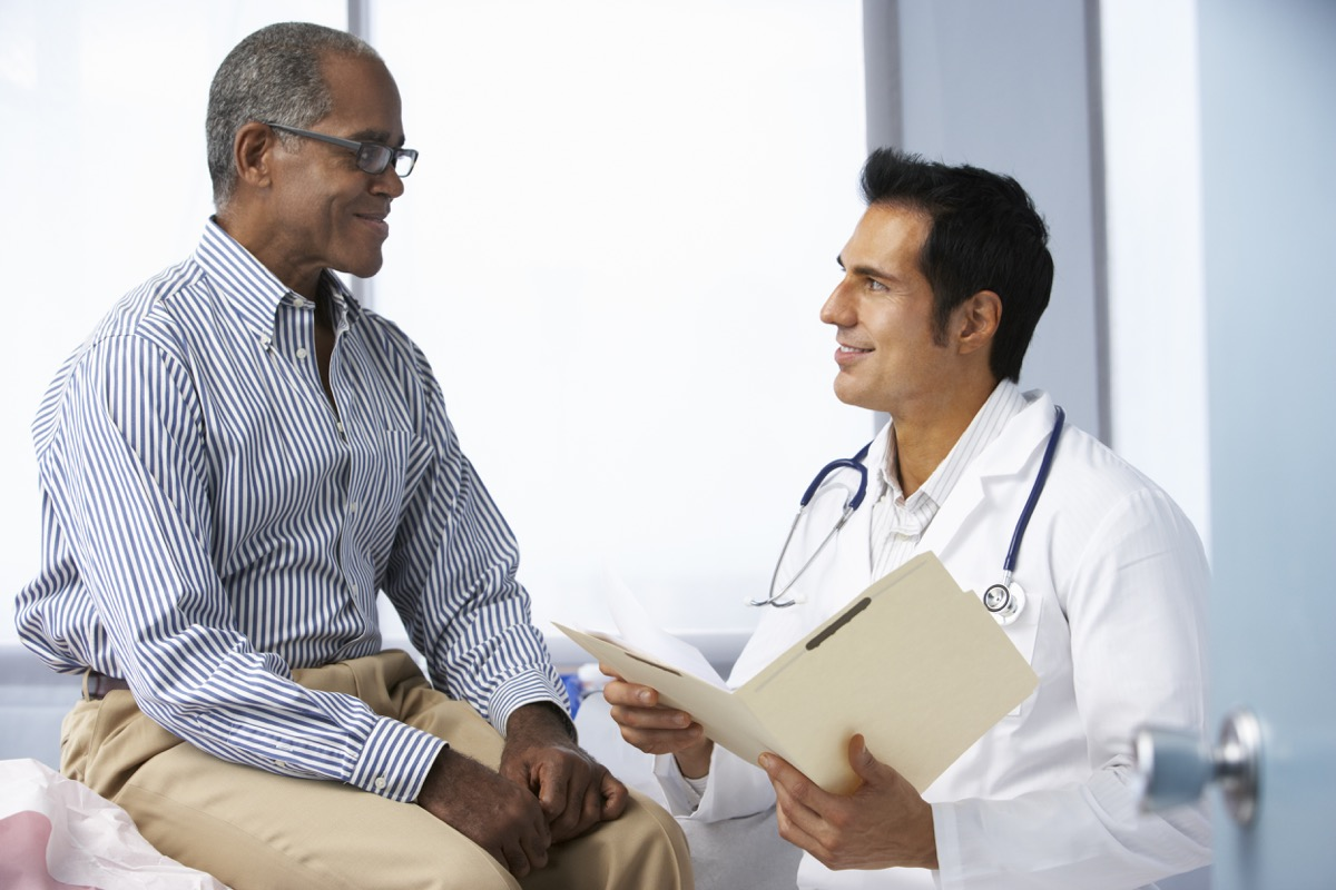 Older man getting checked out at the doctor's office