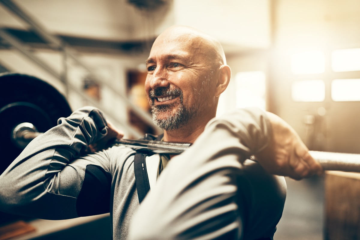 Older Man Lifting Weights at the Gym, look better after 40