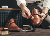 man shining light brown double monk strap shoes