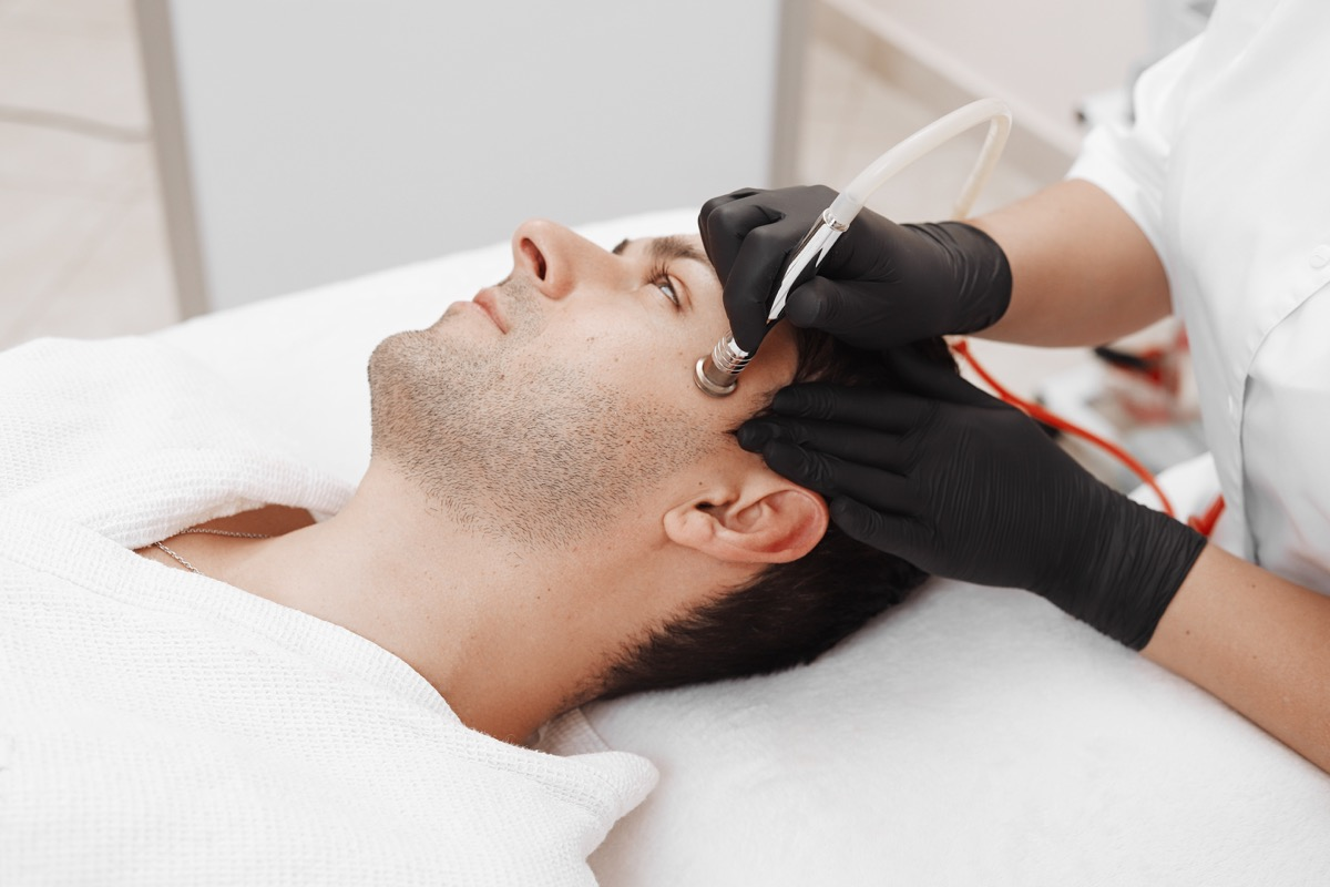 Man getting microdermabrasion treatment
