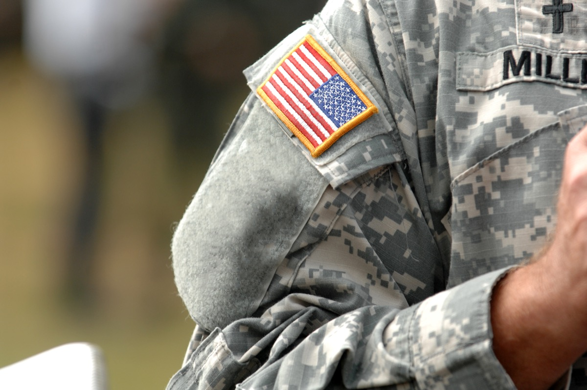 the american flag patch on a military uniform