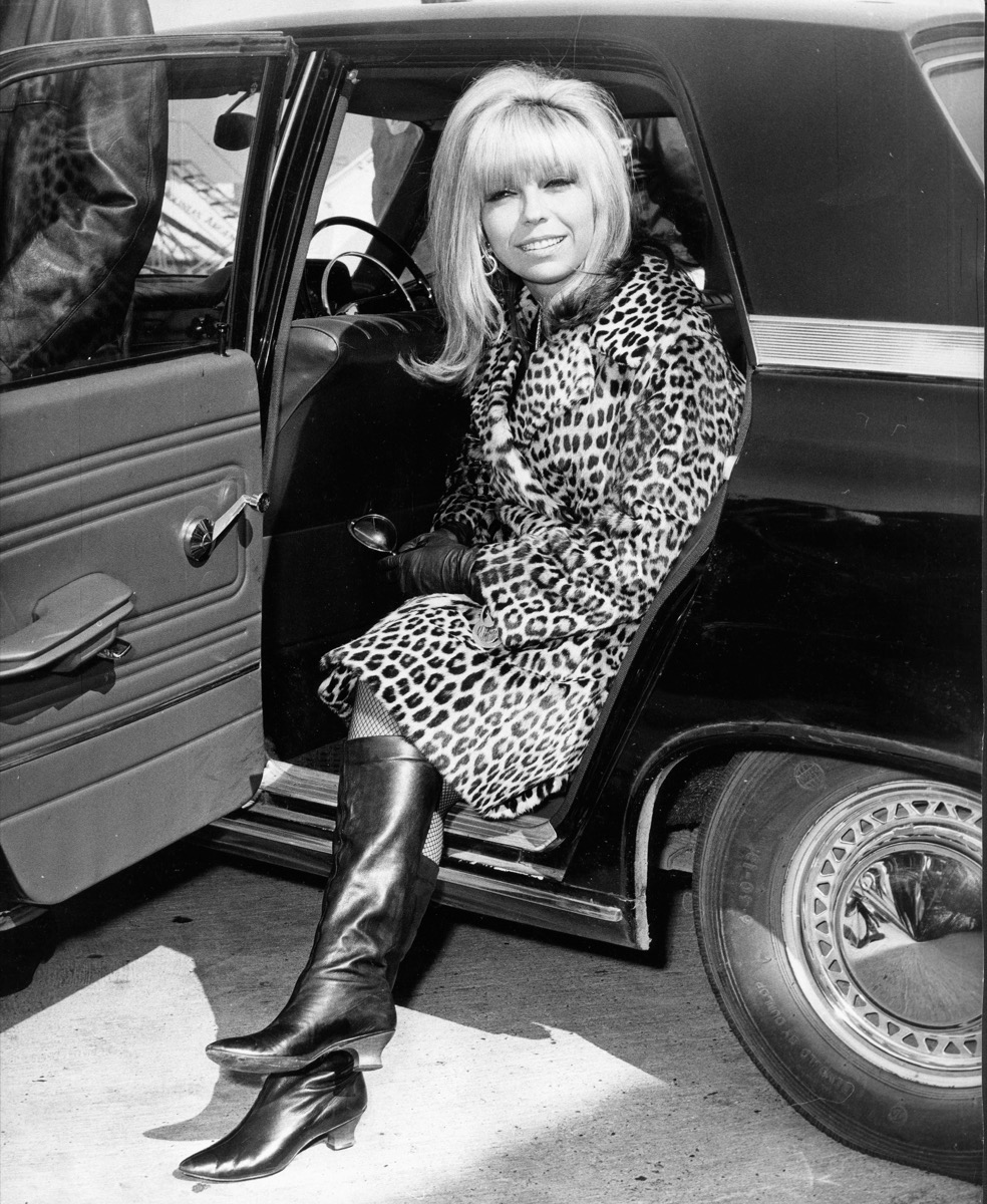 Singer Nancy Sinatra getting out of her car