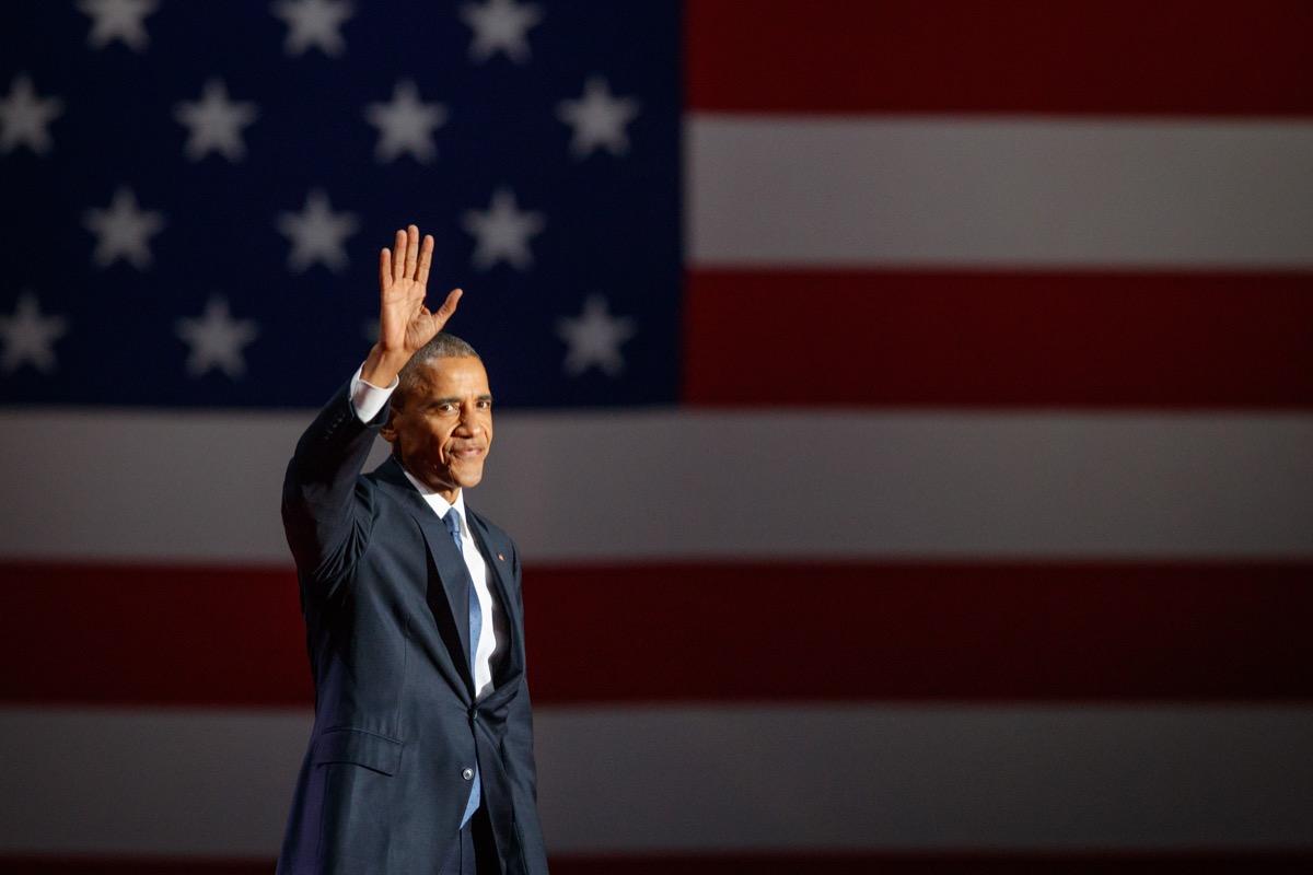 Barack Obama waving American flag