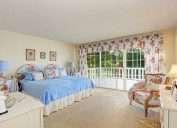 old fashioned home with floral bedding and curtains
