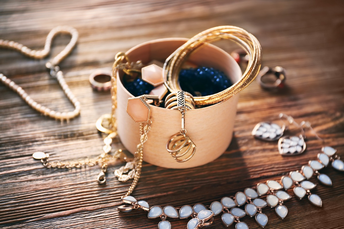 old jewelry on a wooden attic floor things to throw away