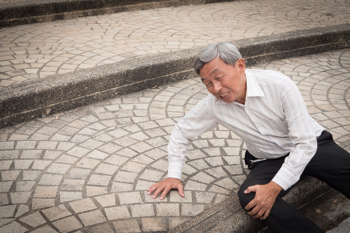 Older Man Falling on the Ground Signs of Poor Health over 50