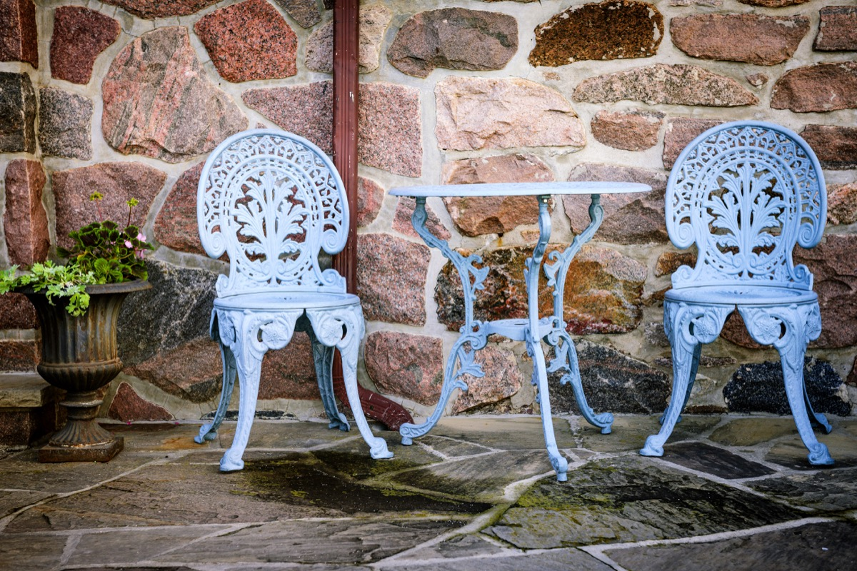 Painted outdoor furniture on patio