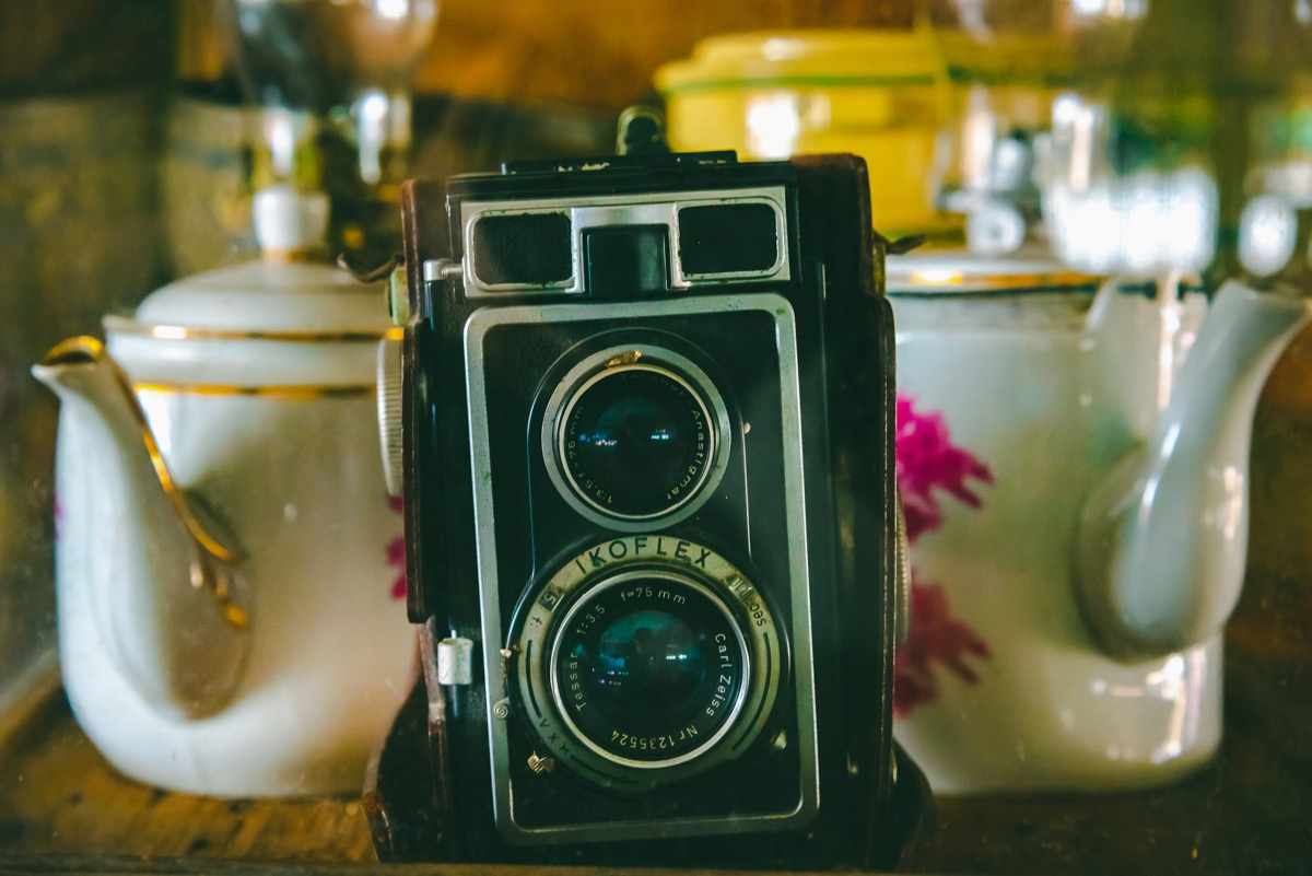 THAILAND, AUGUST 22 2018: Vintage retro Polaroid camera on the wooden table. - Image