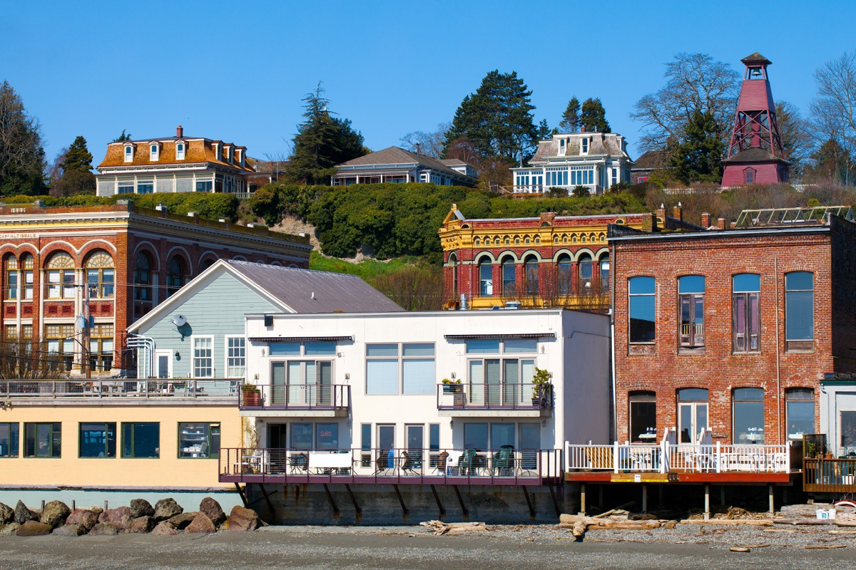 Port Townsend, Washington waterfront view of old Victorian era architecture on a clear sunny day with blue sky. Tourist destination on the Olympic Peninsula in the northwest USA. - Image