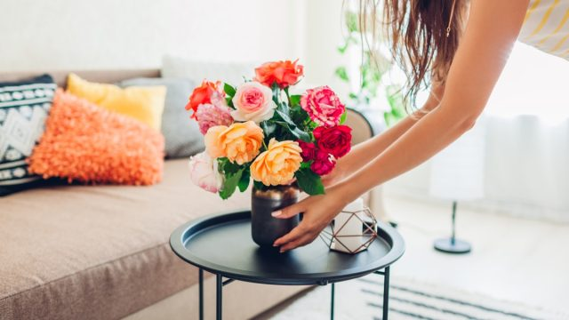 Woman putting out flowers