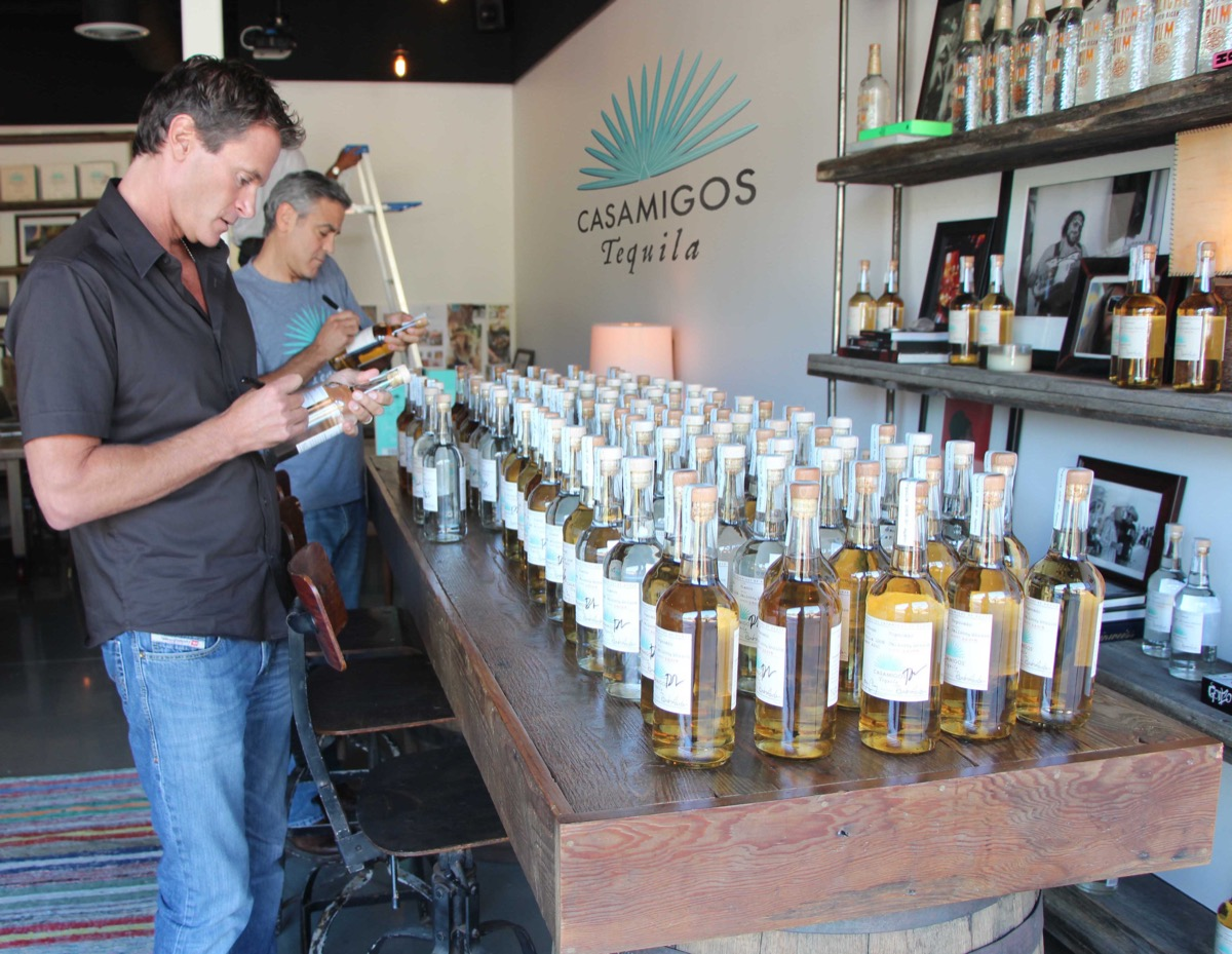 rande gerber and george clooney with casamigos tequila bottles