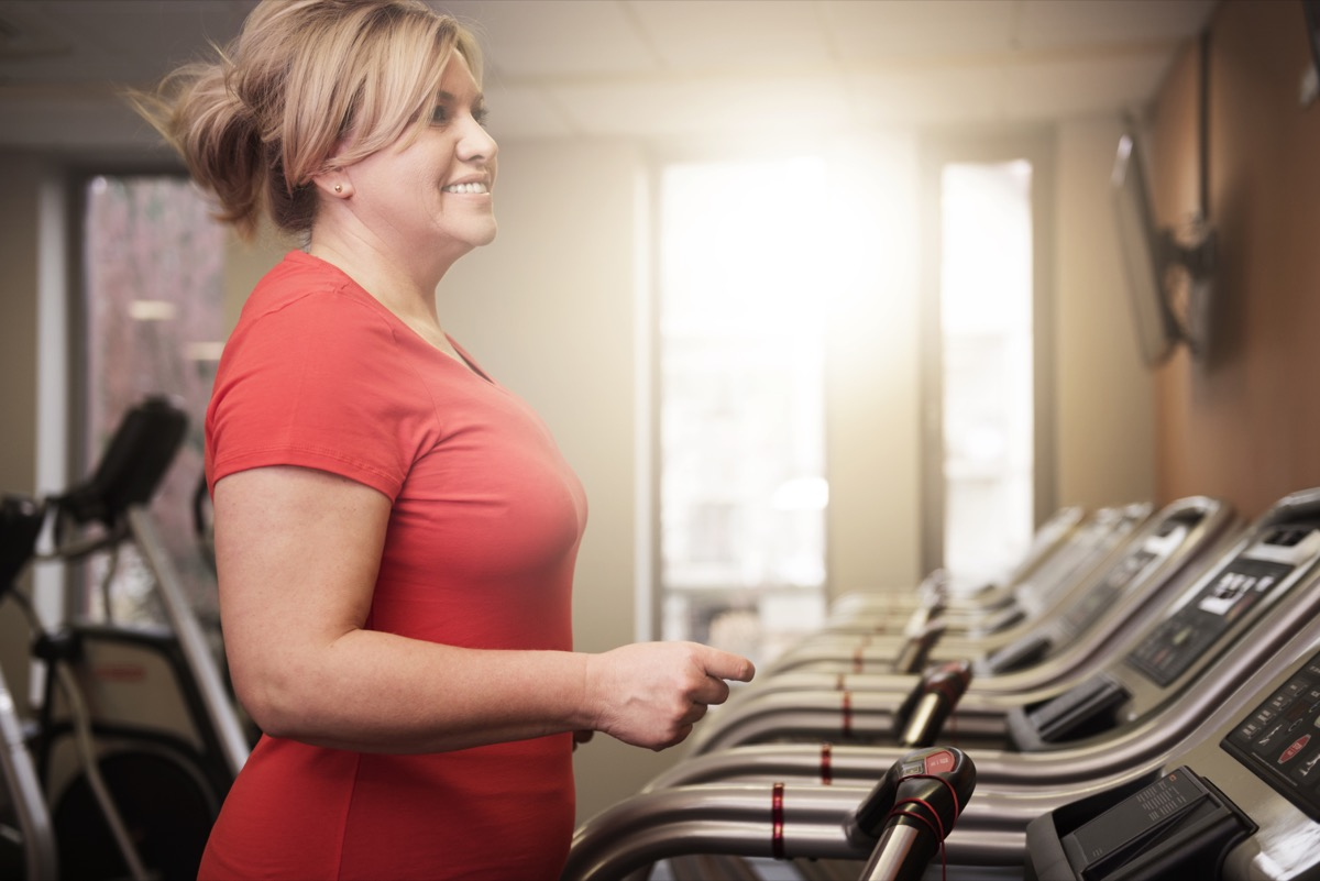 Woman Running on a Treadmill at the Gym {Health Mistakes}