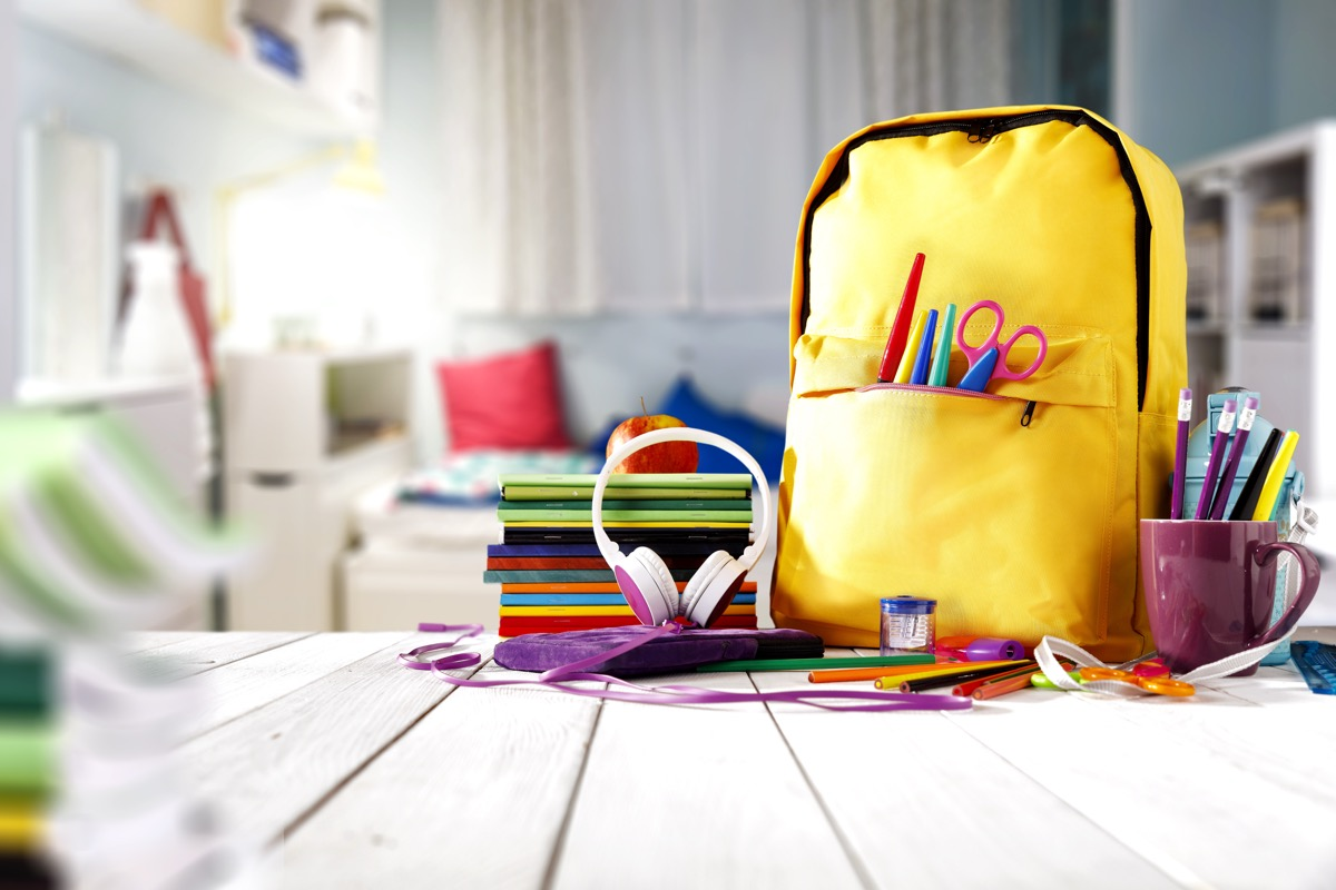 Table of school supplies and a backpack