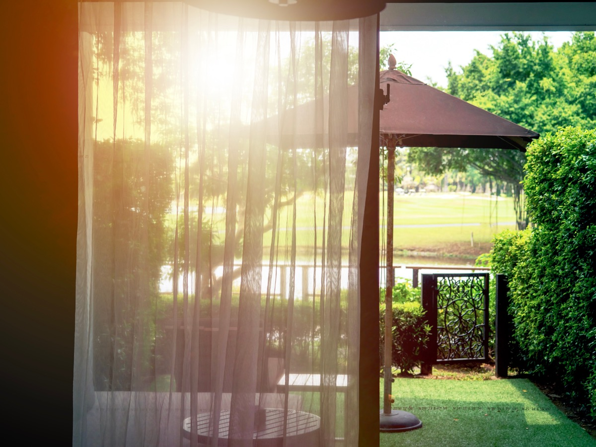 Sheer curtains on sliding glass door to yard