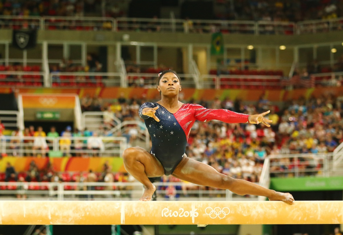 RIO DE JANEIRO, BRAZIL AUGUST 7, 2016: Olympic champion Simone Biles of United States competing on the balance beam at women's all-around gymnastics qualification at Rio 2016 Olympic Games - Image