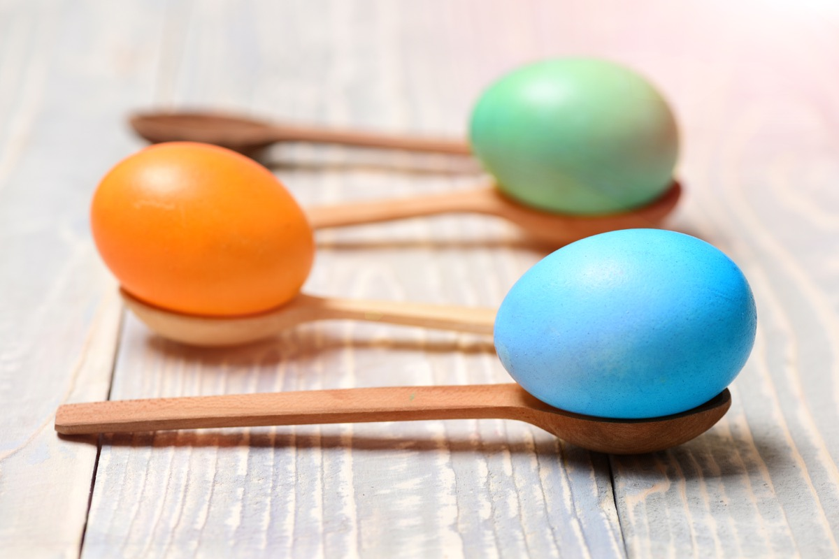 kids playing a spoon and egg race - best easter games