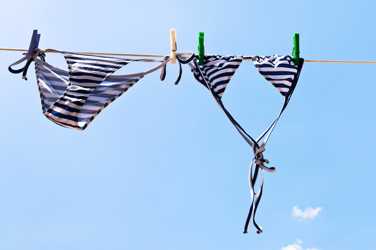 striped bikini on clothing line outdoors