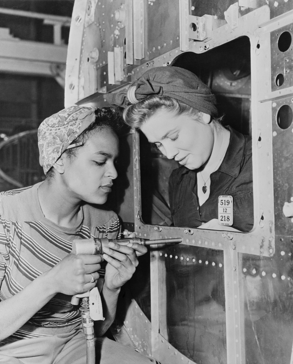 two women war workers working together at the long beach plant in the 1940s, popular hairstyles