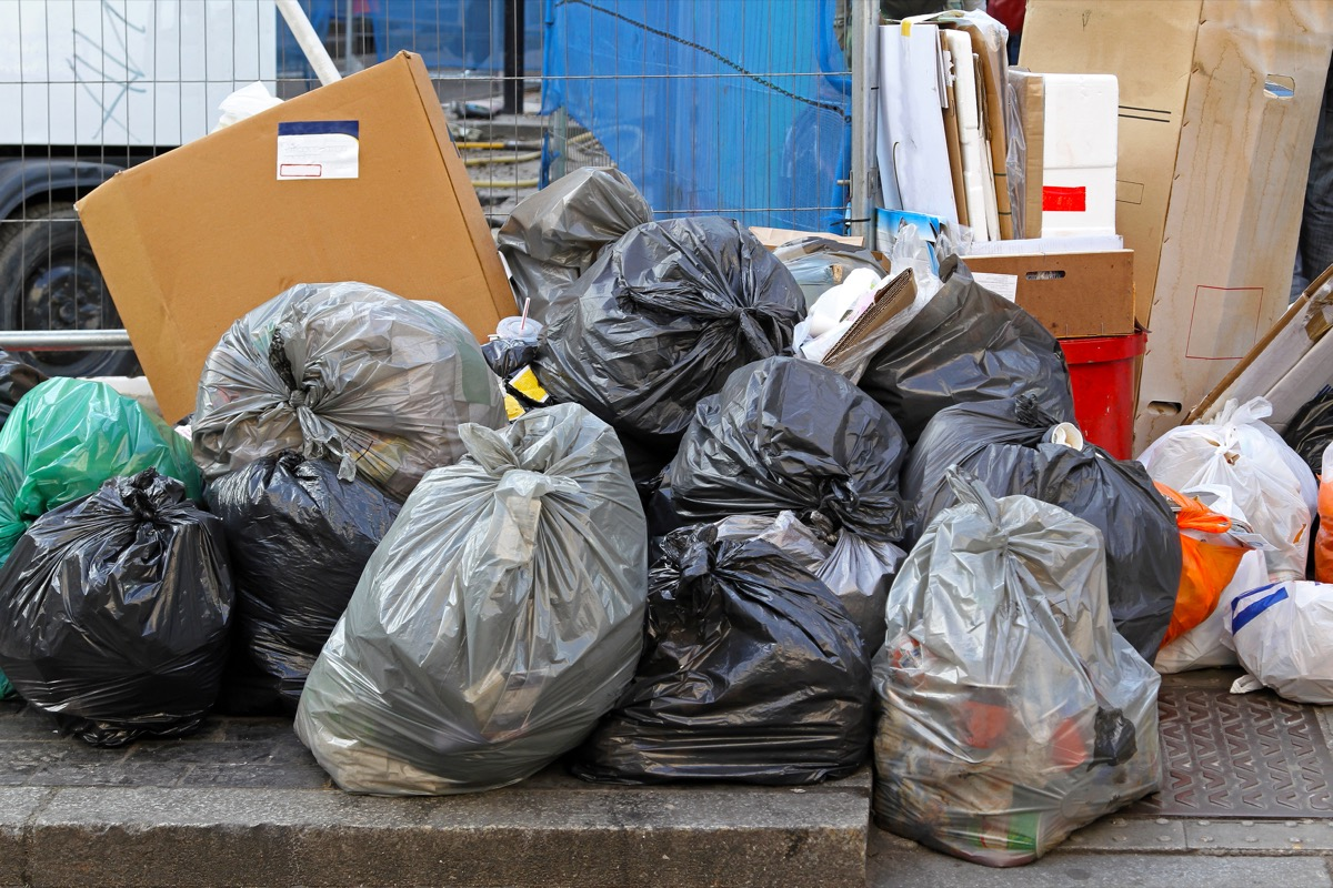 Big pile of garbage and waiste in black bags - Image