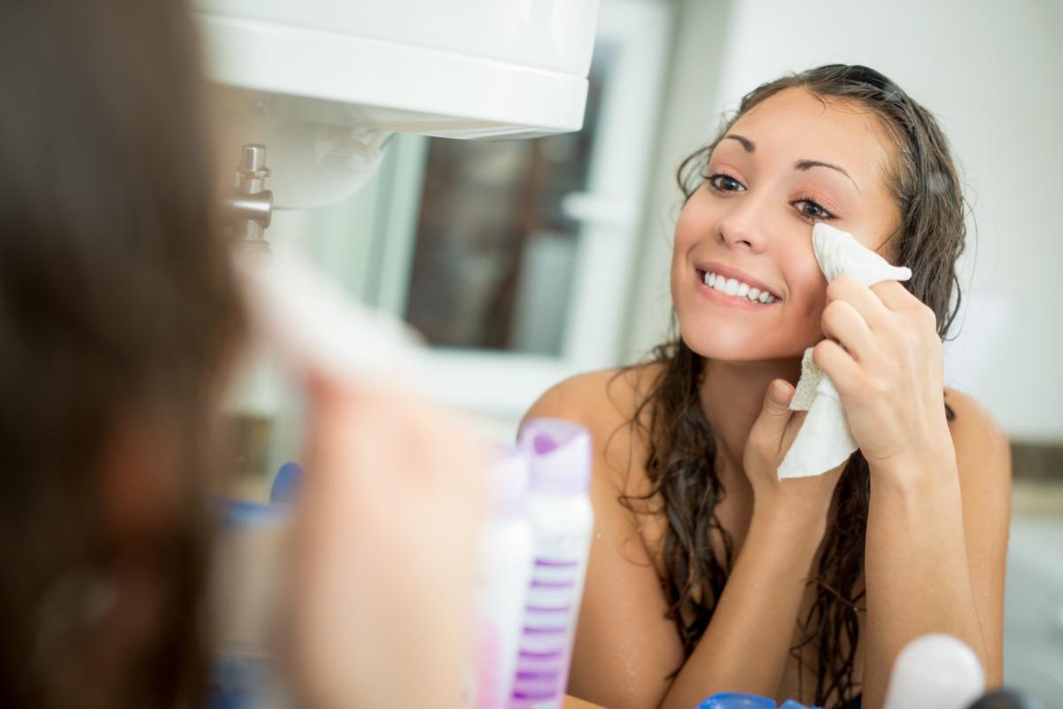 Girl washing face with washcloth