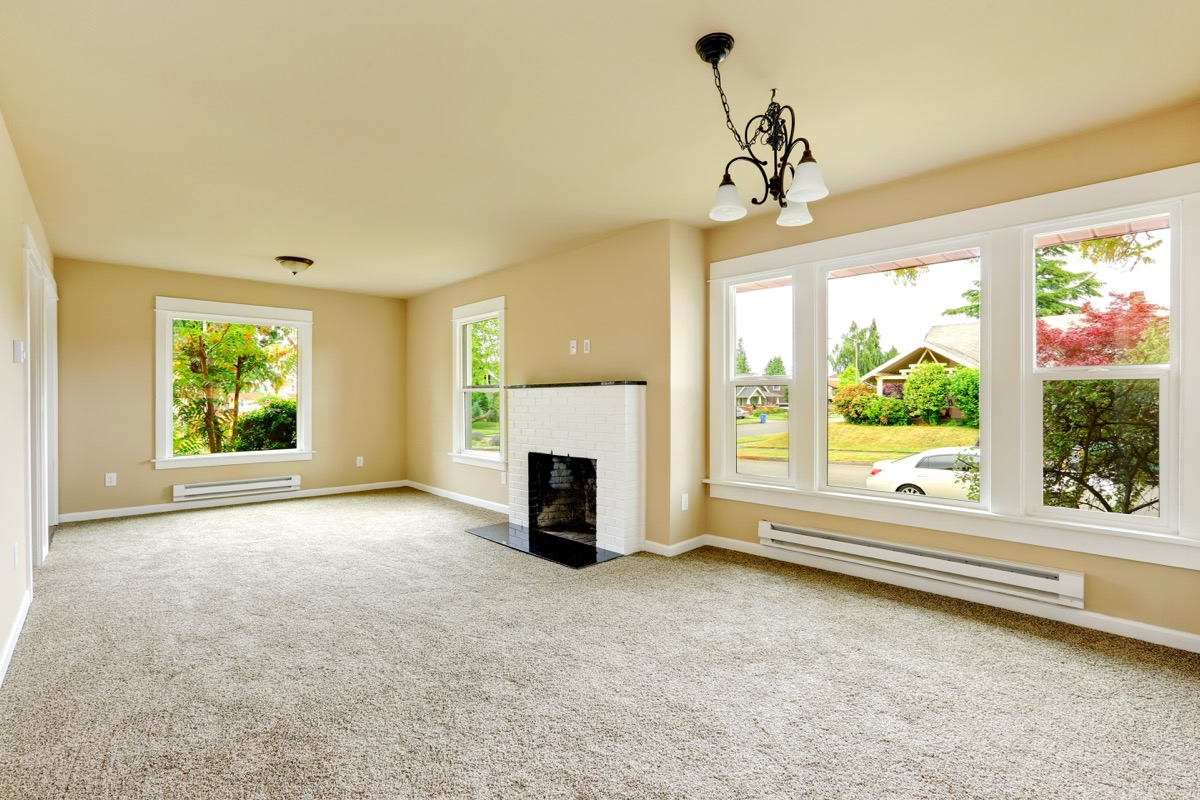 living room with beige wall-to-wall carpet