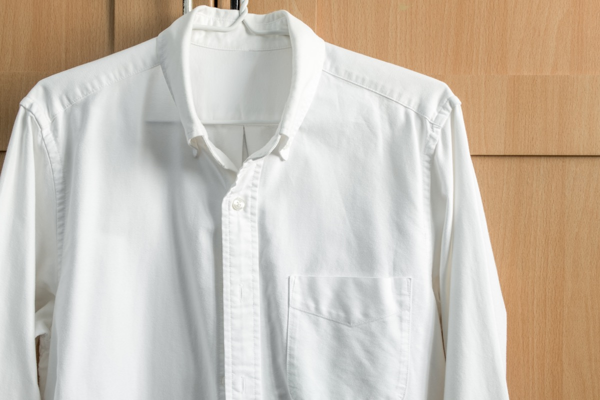white button down shirt hanging up