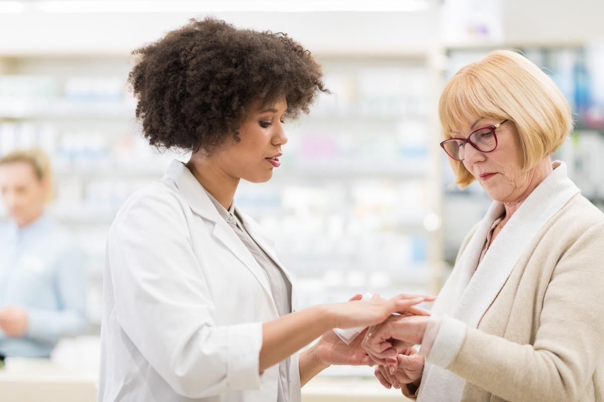 Senior Woman Talking To A Female Pharmacist