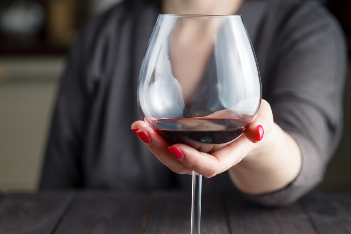 woman holding wine glass, mistakes everyone makes