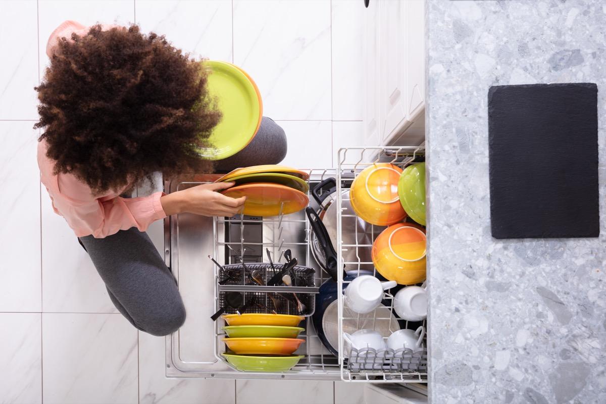 woman loading dishwasher,