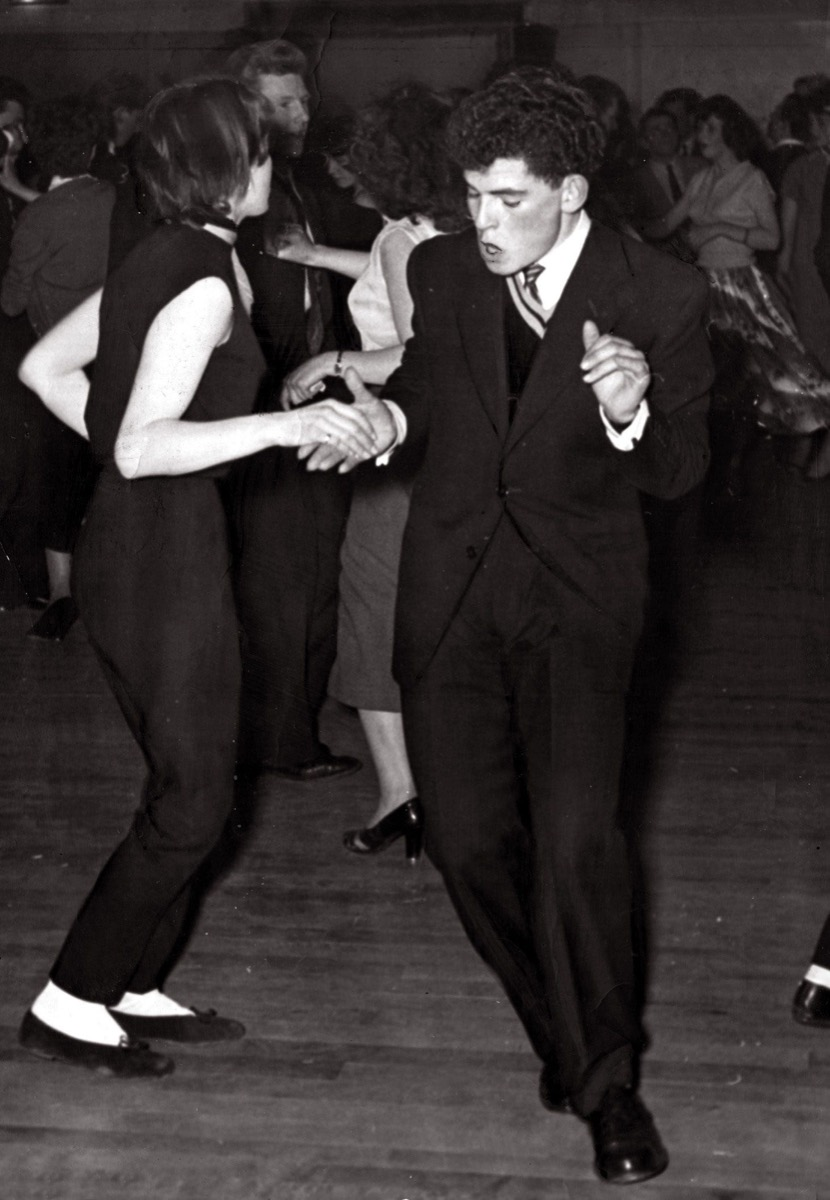1950s young couple jive dancing, cool grandparents