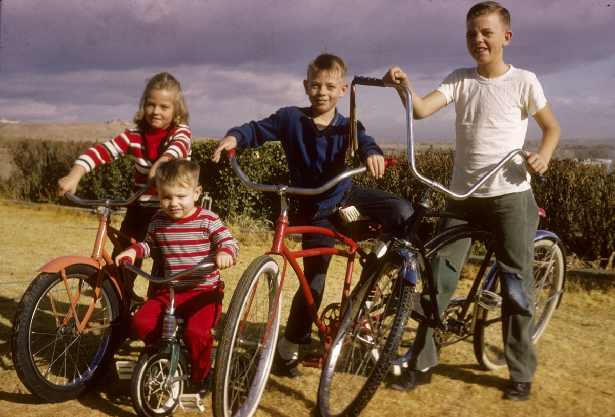 1960s kids on bikes BH3751 Four children on bicycles in 1964.. Image shot 1964. Exact date unknown.